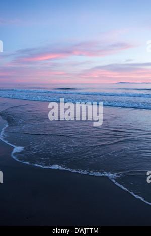 Sunset over the Pacific Ocean at beach along Central Coast of California near Santa Barbara USA - Stock Photo