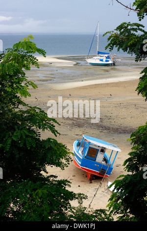 Beached boats on the beach during the low tide, Northern Mozambique. - Stock Photo
