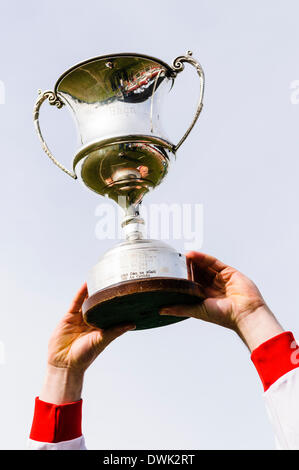Belfast, Northern Ireland. 10 Mar 2014 - A GAA player holds up the Cadburys Ulster Under 21 Football Championship - Stock Photo