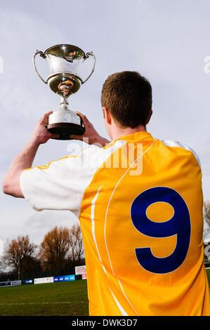Belfast, Northern Ireland. 10 Mar 2014 - An Antrim player holds up the Cadburys Ulster Under 21 Football Championship - Stock Photo