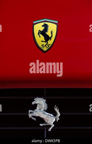 Ferrari 'Prancing Horse' symbol on the front of a Ferrari sports car - Stock Photo