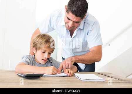 Father assisting son in homework - Stock Photo