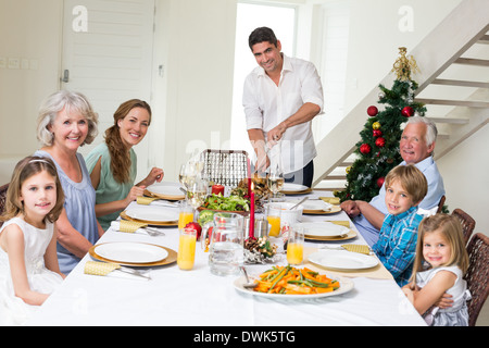 Family having Christmas meal at dining table - Stock Photo