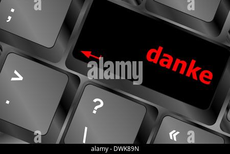 a danke message on enter key of keyboard - Stock Photo