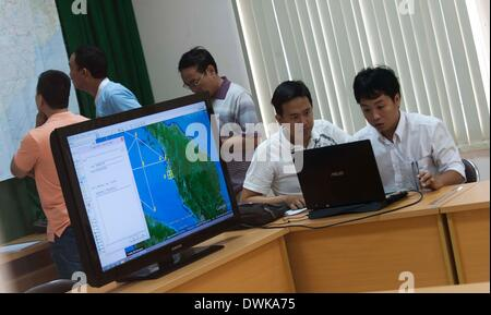 Phu Quoc Island, Vietnam. 11th Mar, 2014. Staff members work at the rescue command office for the missing Malaysia - Stock Photo