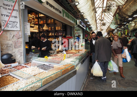 People shopping and mingling at Mehane Yehuda Market, Jaffa St, Jerusalem, Israel - Stock Photo