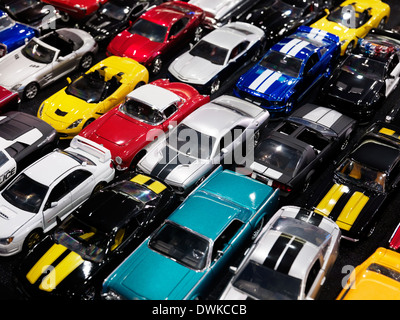 Diecast toy car models, colorful classic and sports cars - Stock Photo