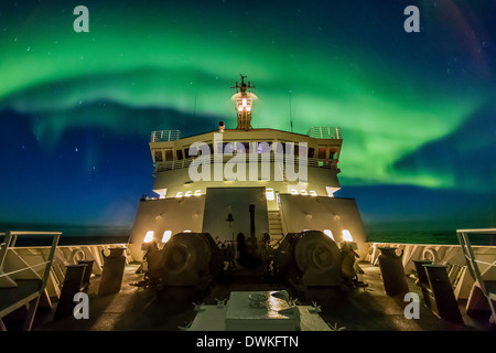 Aurora borealis (Northern Lights) above the Lindblad Expeditions ship in Hudson Strait, Nunavut, Canada - Stock Photo