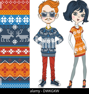 fashion hipster boy and girl in knitted sweaters with Norwegian seamless pattern - Stock Photo