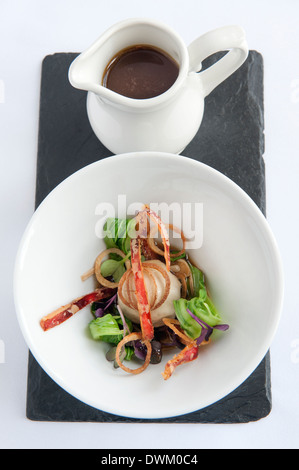 Warm chicken broth with steamed dumpling,oriental vegetables,sesame and soy - Stock Photo