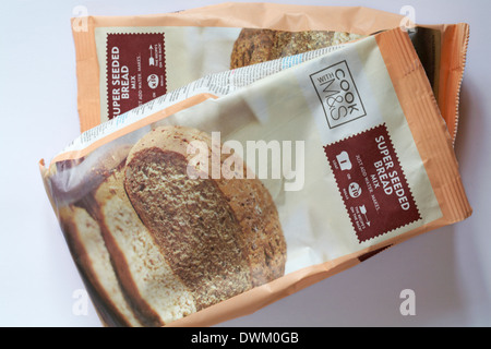 Pack of Cook with M&S super seeded bread mix set on white background - Stock Photo