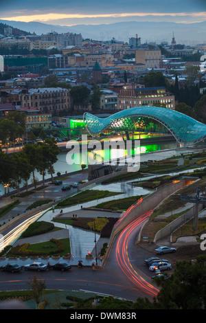 View towards Rike Park and Peace Bridge over Mtkvari (Kura) River and the city, Tbilisi, Georgia, Caucasus, Central - Stock Photo
