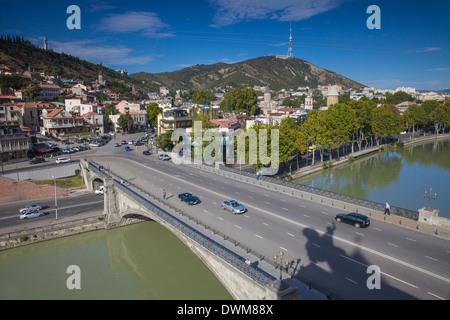 View over Mtkvari (Kura) River towards Old Town, Tbilisi, Georgia, Caucasus, Central Asia, Asia - Stock Photo