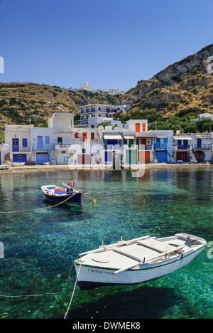 Syrmata houses in the seaside village of Klima, Milos Island, Cyclades, Greece - Stock Photo