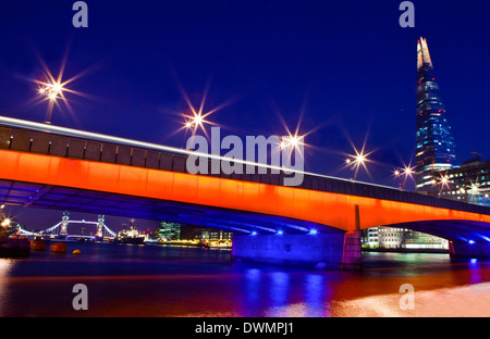 The Shard, London Bridge and Tower Bridge spanning over the River Thames in London. - Stock Photo