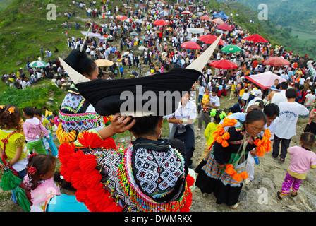 Long Horn Miao girls in traditional costumes celebrating summer Festival, around Zhijian, Guizhou Province, China, - Stock Photo