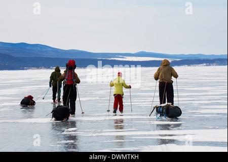 Ice skating, Maloe More (Little Sea), Olkhon island, Lake Baikal, UNESCO Site, Irkutsk Oblast, Siberia, Russia - Stock Photo