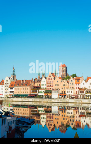 Canal side houses and skyline, Gdansk, Poland, Europe - Stock Photo