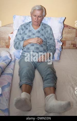 Senior man sleeping in bed. - Stock Photo