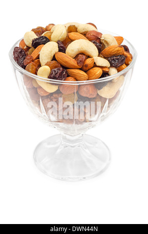 Mixed nuts and dry fruits in glass bowl isolated over white background - Stock Photo