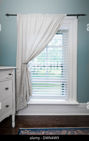 Window with venetian blinds and white curtain in country style room - Stock Photo