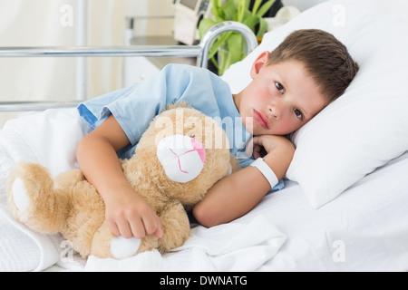Little boy with teddy bear in hospital - Stock Photo