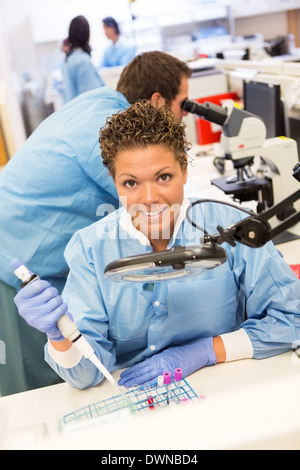 Female Researcher Working In Laboratory - Stock Photo