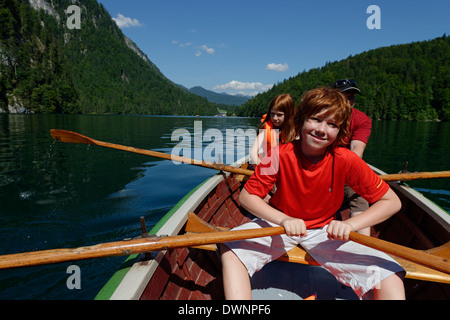 Children in a rowing boat on lake Königssee, Berchtesgadener Land district, Upper Bavaria, Bavaria, Germany - Stock Photo