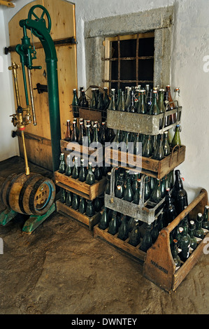 Bottling equipment and beer crates, historic Schöpf-Brauerei brewery, in Markus Wasmeier Farm and Winter Sports - Stock Photo
