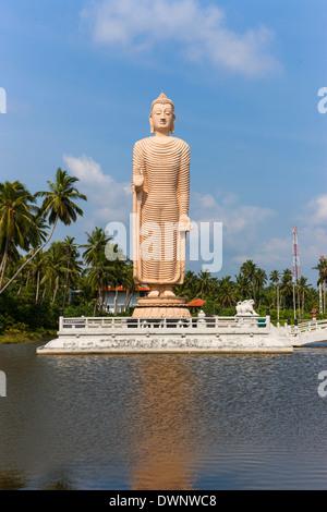 Buddha sculpture, memorial of the Tsunami disaster on 26.12.2006, Pereliya region, Southern Province, Sri Lanka - Stock Photo