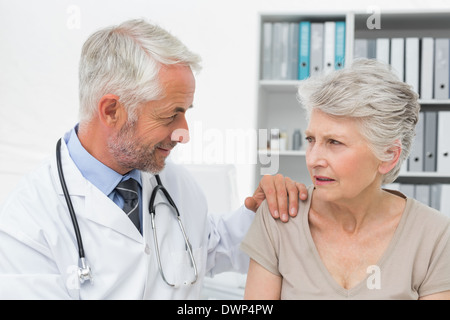 Female senior patient visiting a doctor - Stock Photo