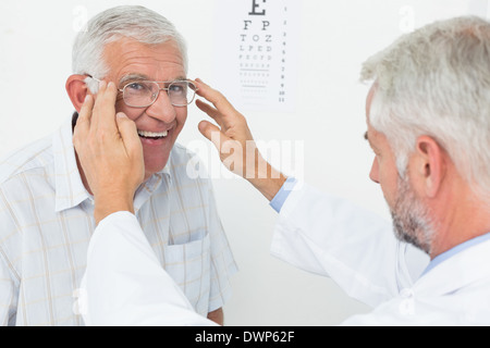 Man wearing glasses after taking vision test at doctor - Stock Photo
