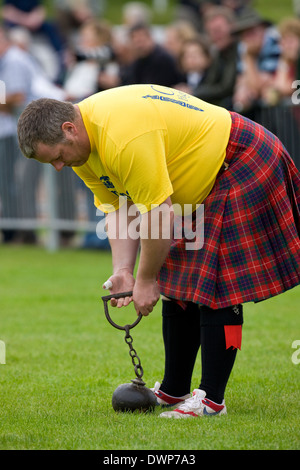 Sportsman about to 'Throw the Hammer' at the Cowal Gathering. A traditional Highland Games held each year in Dunoon - Stock Photo