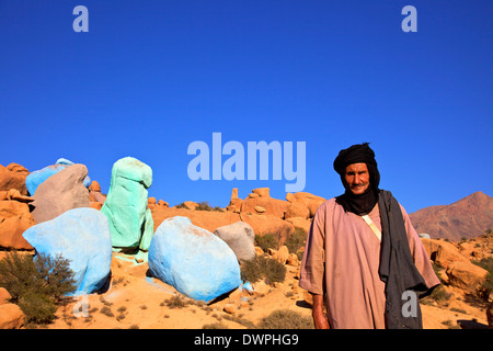 Goat Herder With Painted Rocks By Belgian Artist Jean Verame, Tafraoute, Morocco, North Africa - Stock Photo