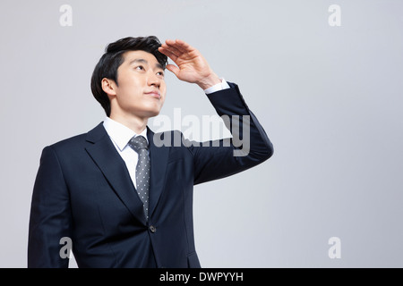 a businessman searching for something - Stock Photo