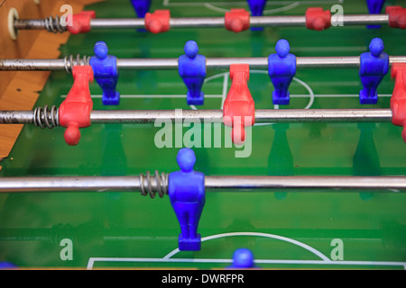 foosball table game in action, motion blur - Stock Photo