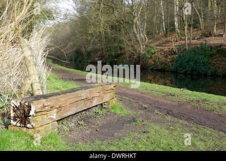 Wooden Bench Alongside Staffordshire & Worcestershire Canal, Gothersley, Staffordshire, England, UK - Stock Photo
