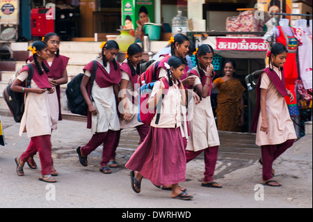South Southern India Tamil Nadu Madurai street scene young schoolchildren schoolgirls school girls in uniform walking - Stock Photo