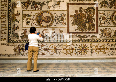 North Africa, Tunisia, Tunis. The Bardo Museum. Tourist front of Roman fresco mosaic. - Stock Photo
