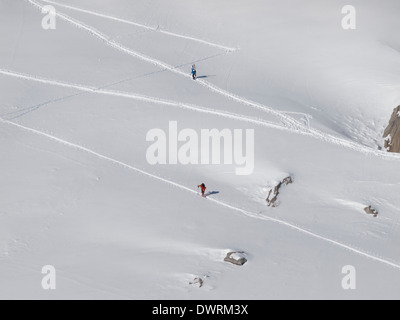 ski tourists going up - Stock Photo