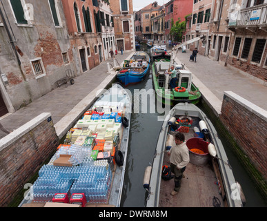 Cargo delivery boats are waiting in a channel of historic Venice - Stock Photo