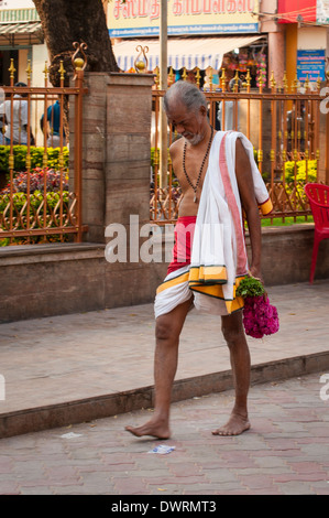 South Southern India Tamil Nadu Madurai Minakshi Sundareshvara Shiva Hindu Temple parade worshiper with garland - Stock Photo