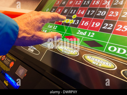 Fixed odds roulette machine (FOBT fixed odds betting terminal) in Bookmakers. UK - Stock Photo