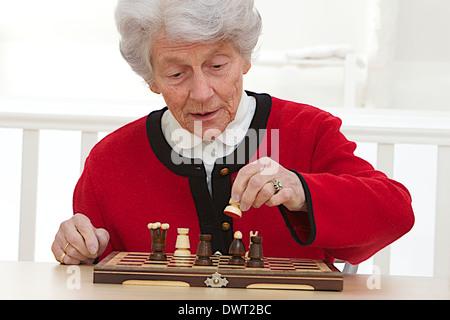 Elderly people playing chess - Stock Photo