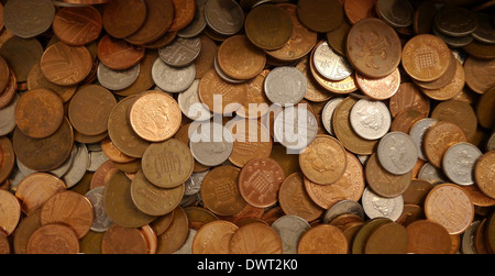 A pile of loose change - UK coins and one odd 5 cent piece - Stock Photo
