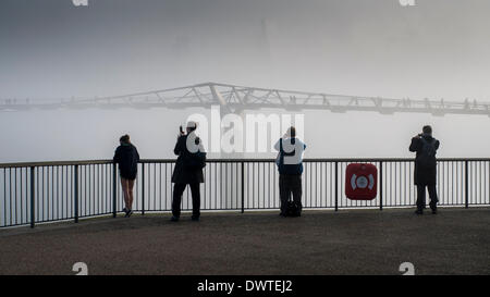The City Skyline disappears in this morning's heavy fog and makes commuters whip out their Camera Phones on way - Stock Photo