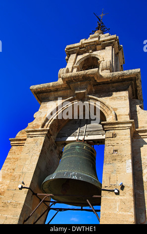 The bell at the top of the Cathedral tower, La Miguelete, against a bright blue sky in Valencia, Spain - Stock Photo