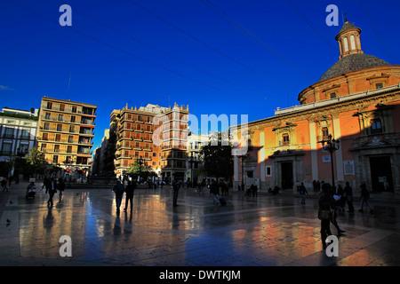 A general view at dusk of the Plaza de la Virgen and the Basilica de la Virgen de los Desamparados, Valencia, Spain - Stock Photo