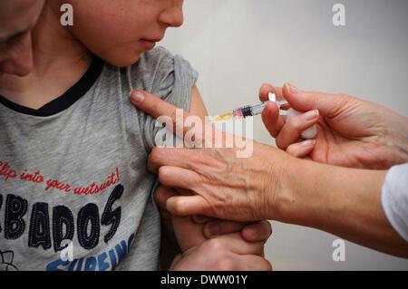 Vaccine child - Stock Photo