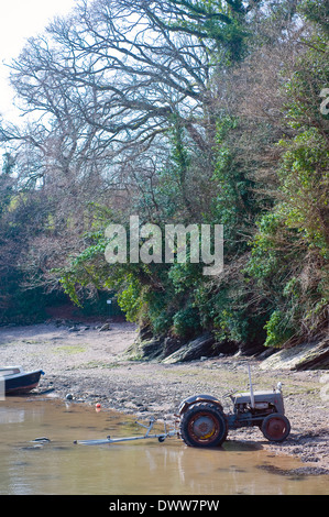 tractor on foreshore at stoke gabriel devon,tractor, tire, rust, dirty, date, wheels, 1950, agriculture, seaside, - Stock Photo